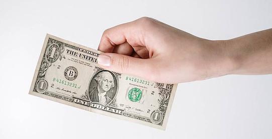 hand holding dollar bill
